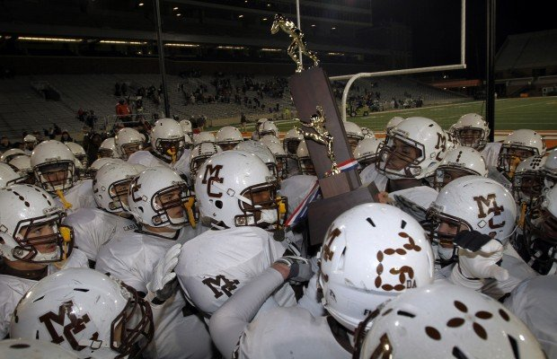 Mount Carmel players quietly carry their second-place trophy