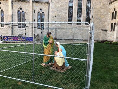Indianapolis church locks up Holy Family to protest Trump border policies