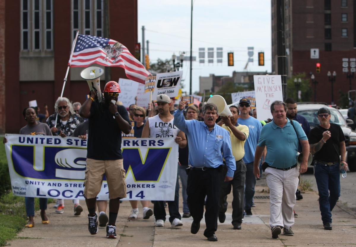 USW protests layoffs of 75, pay cuts for 200
