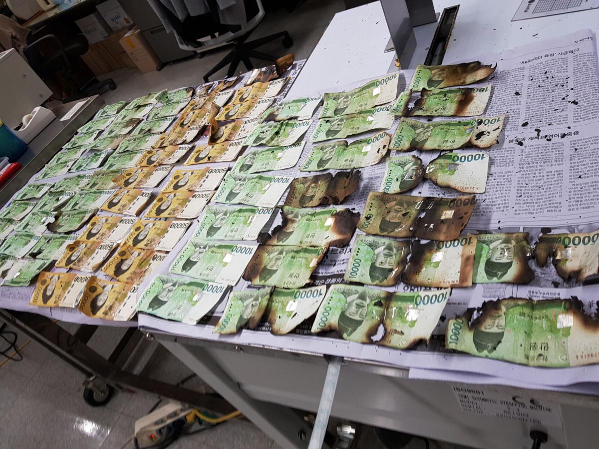 South Korea Virus Outbreak Cleaning Cash