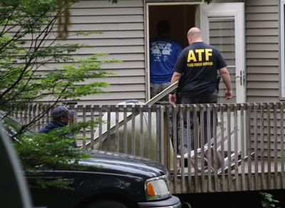 Multiple agencies raid Outlaws hang-out in homicide probe