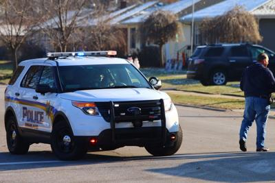 Police responding to report of man with gun barricaded inside Highland home