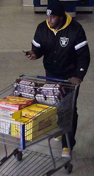 Suspects caught on camera loading up cases of candy after Pennsylvania woman reports $1,100 in charges