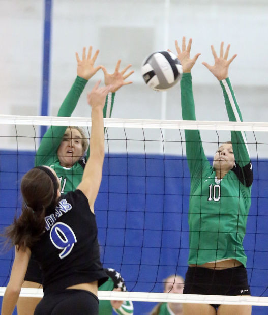 Lake Central's Brooke Renner tries to hit between the block attempt of Valparaiso's Timi Stiscak and Rachel Bontrager on Thursday.