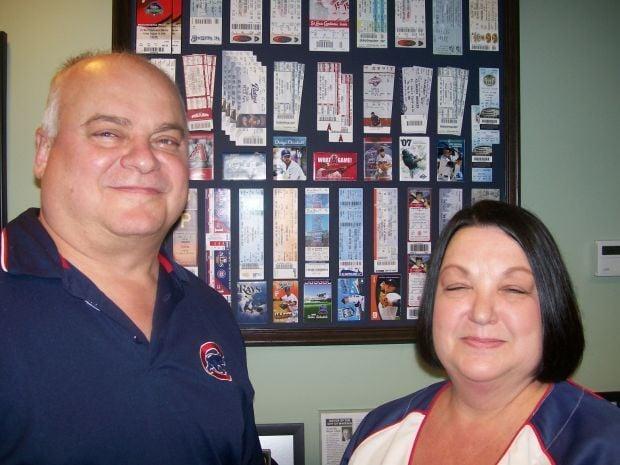 Joe, Diane Stahura with game tickets
