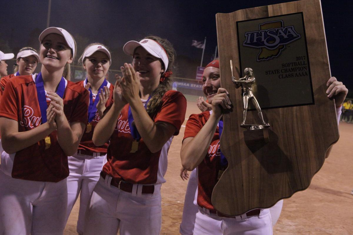 Crown Point players hoist trophy