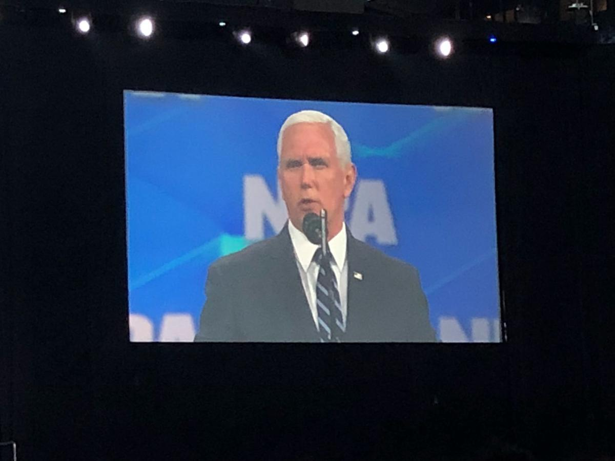 Trump, Holcomb sign gun rights protections at NRA national convention in Indianapolis