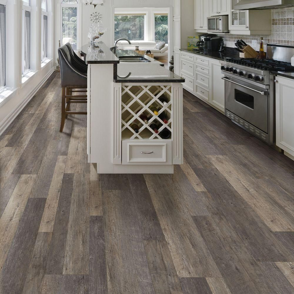 Vinyl makes a comeback in tile plank designs with new for Dark wood vinyl flooring