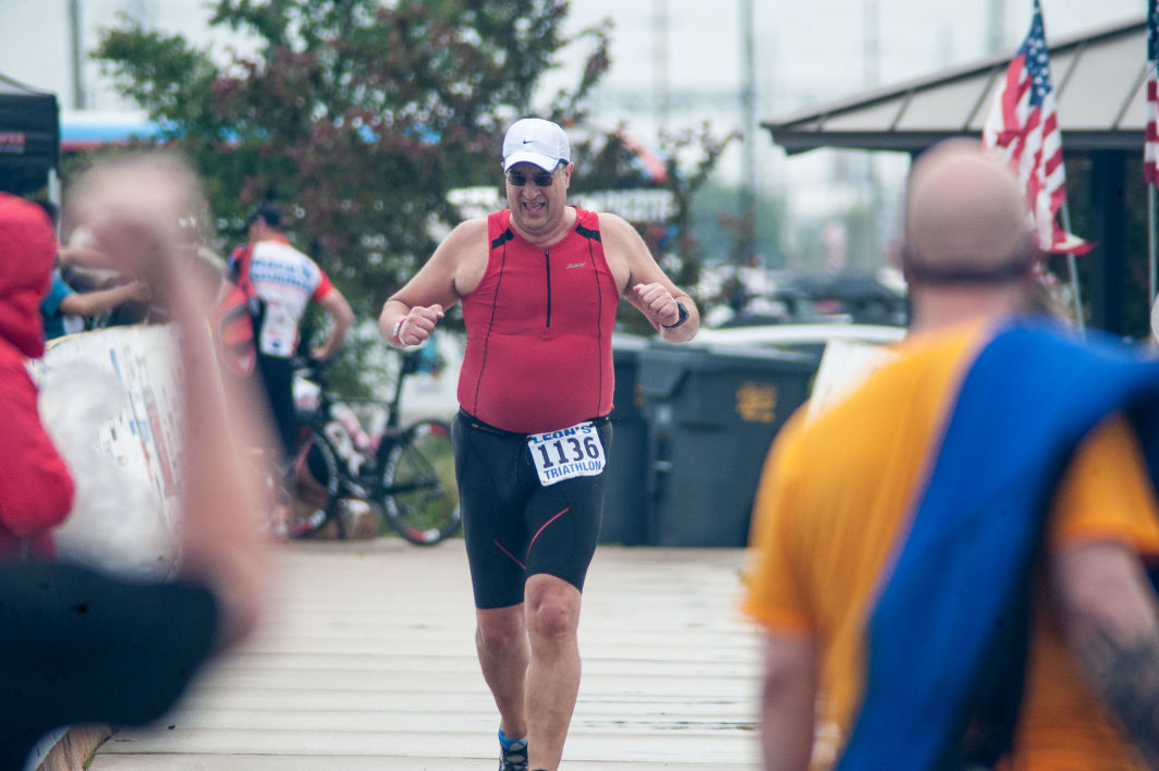 Fellow racers and fans cheer as the final racers cross the finish line at Leon's Triathlon