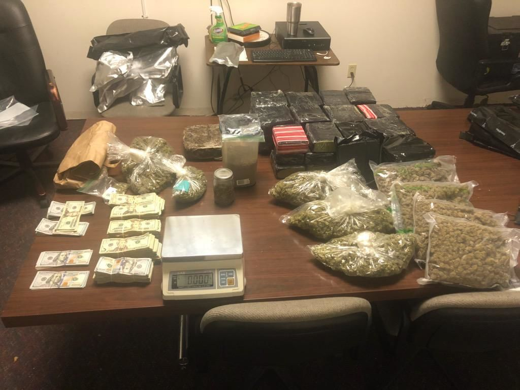 Police seize 50 pounds of marijuana, more than $50K in raid