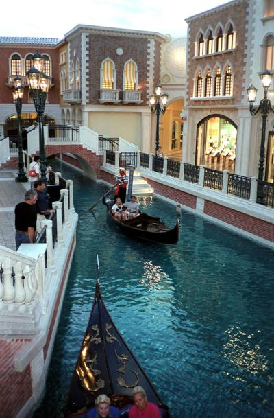 The Venetian Hotel, here in a 1999 file image, is set on a Grand Canal. The hotel is offering a a four-night $450,000 package that pulls out all the stops.