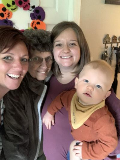 4 generations of smiling faces