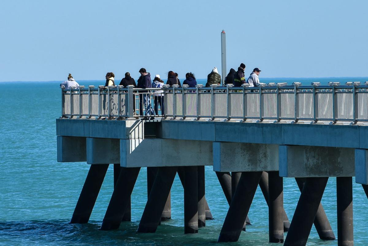 Family and Friends Gather on Pier While Search Continues