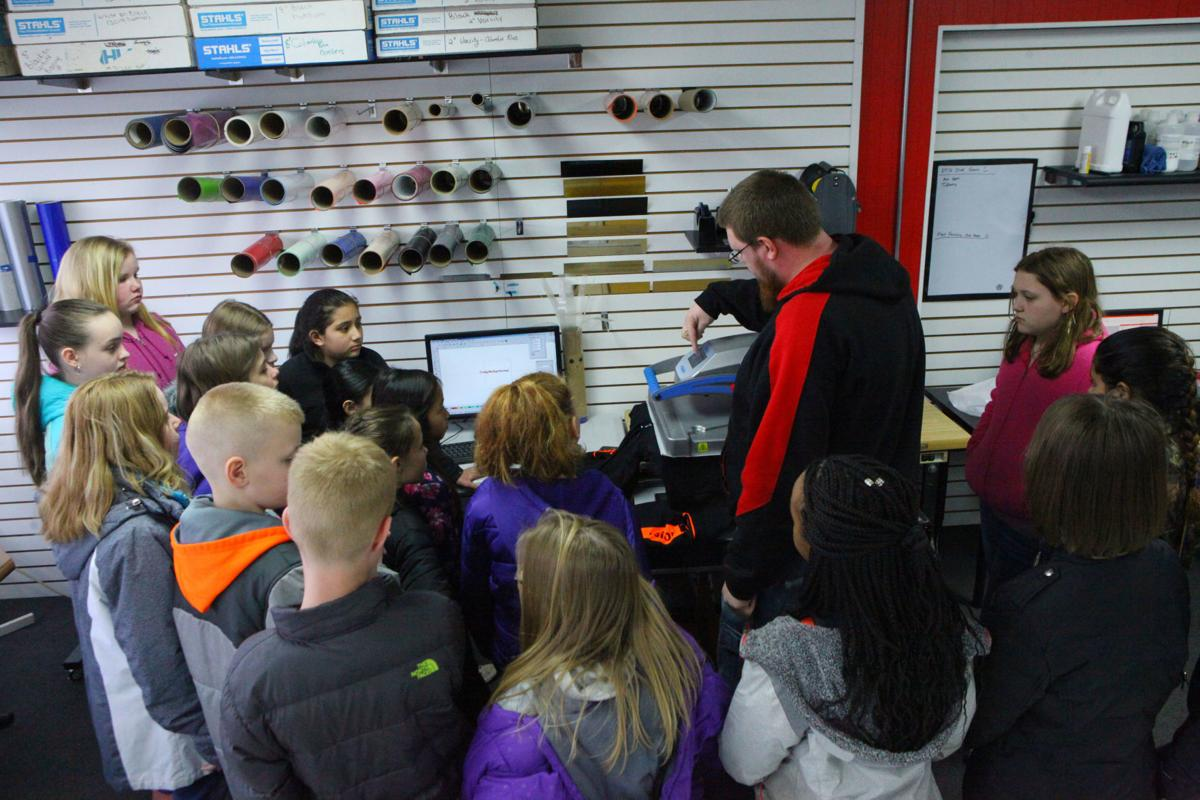 Myers Elementary School students visit Portage Custom Wear