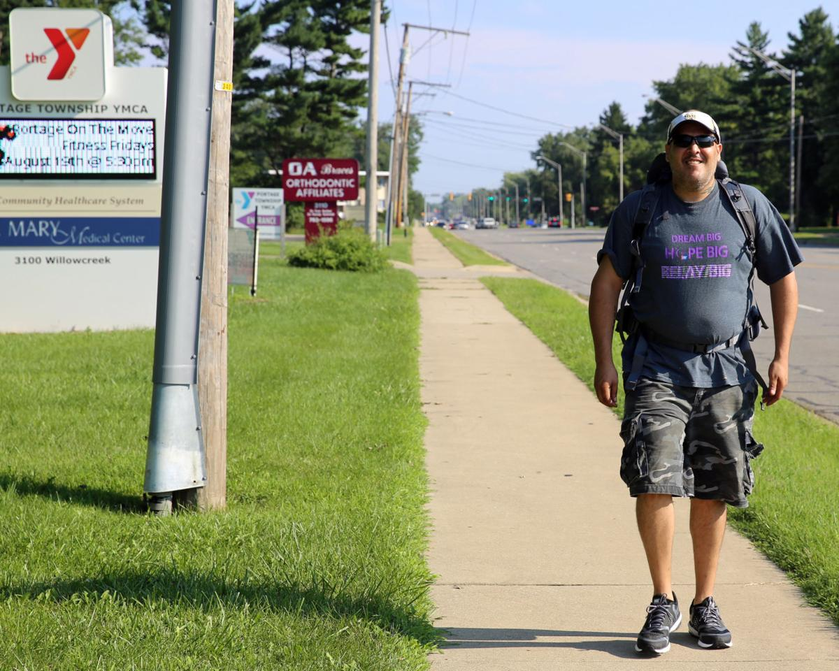 Portage man continues cancer fight after walk across county
