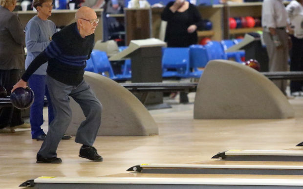 Woody Messmer is 97 years old and captain of the bowling league called the Griffith Seniors.