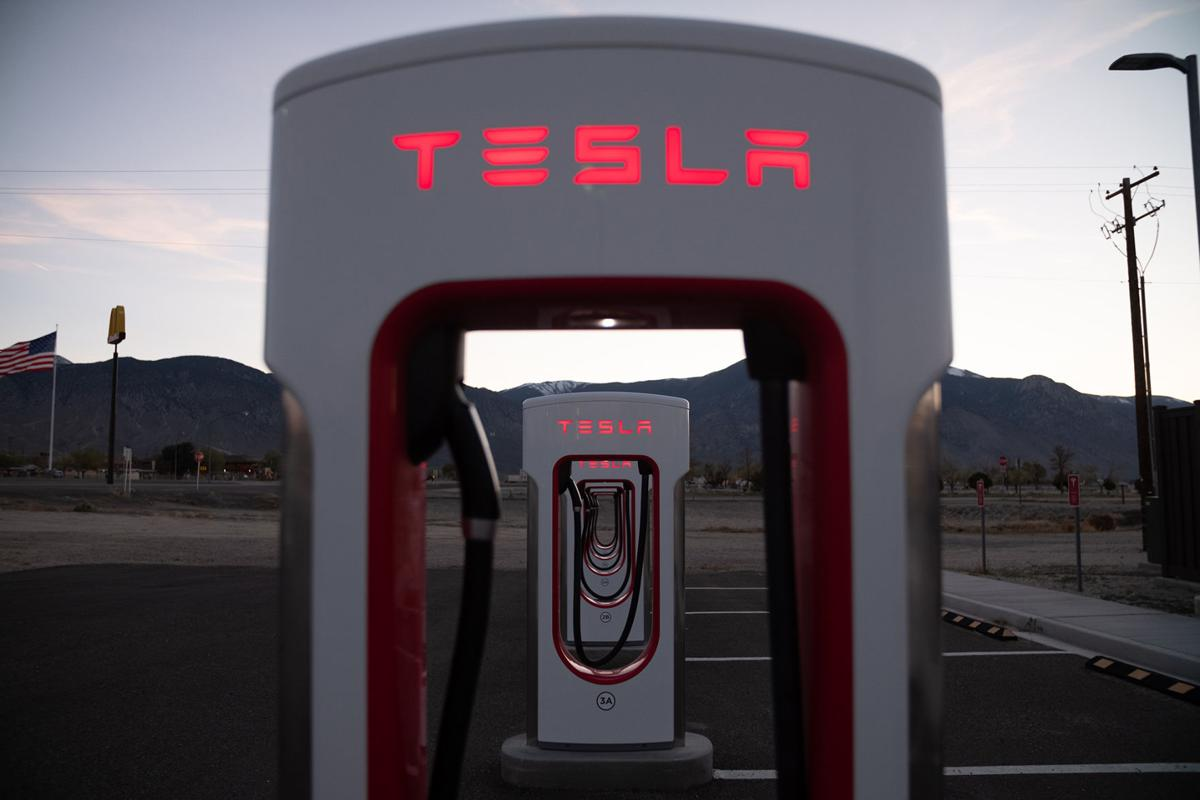 A Tesla supercharging station sits empty at sunset on April 23, 2019 in Hawthorne, Nev. Stations like this have been built across the U.S. and along Nevada's electric highway to give Tesla drivers the ability to travel long distances.
