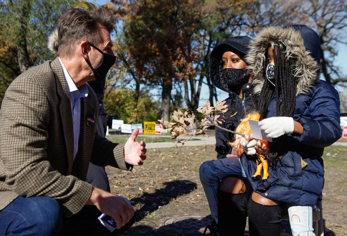 Frank Mrvan talks with voters