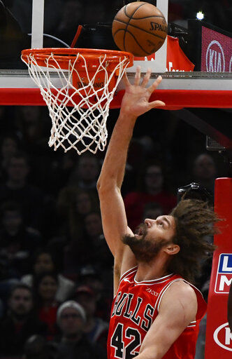Len scores 28, Hawks hold on to beat Bulls 123-118