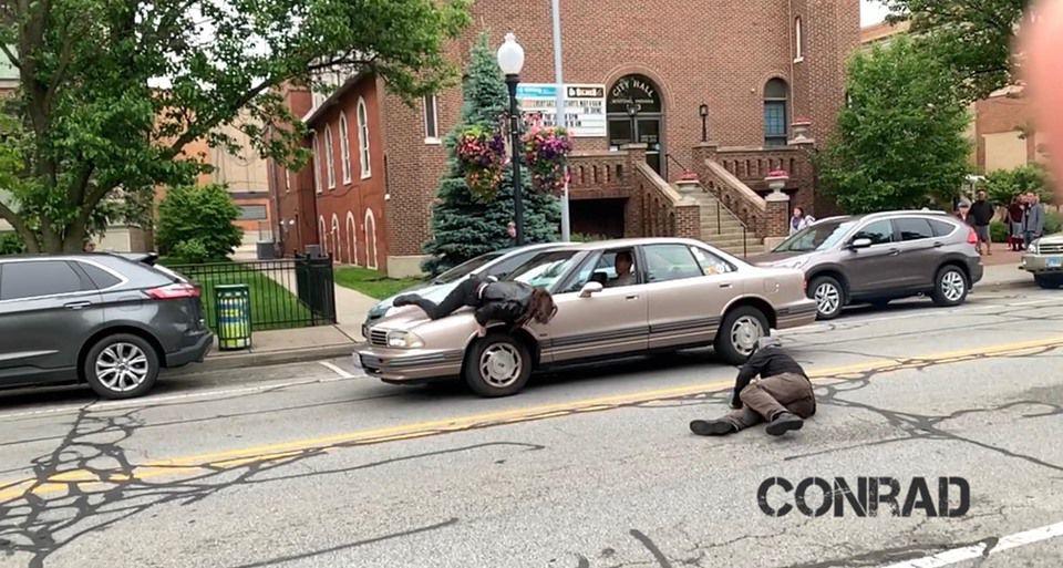 WEB ONLY conrad 6 car scene.jpg