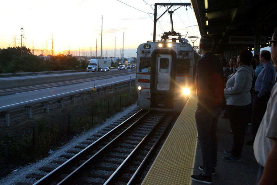 A westbound South Shore Line train arrives at the East Chicago train station