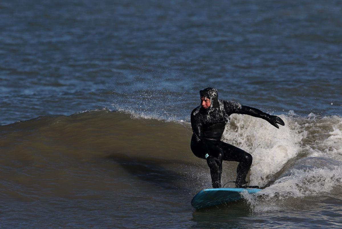 Surfing at Whihala Beach