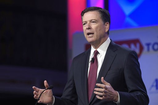 The Latest: FBI corrects Comey testimony on Clinton aide