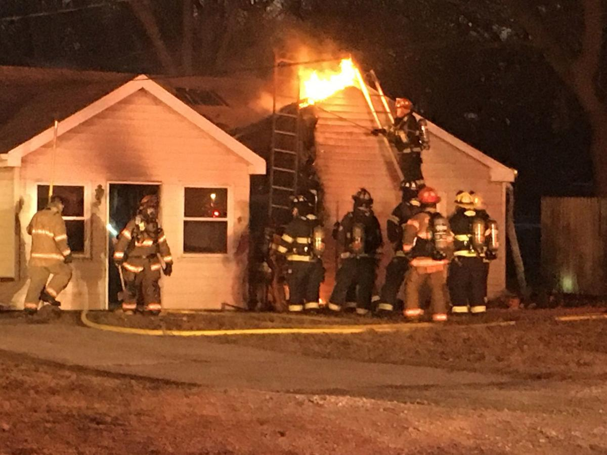 Firefighters Cut Hole In Roof To Put Out House Fire