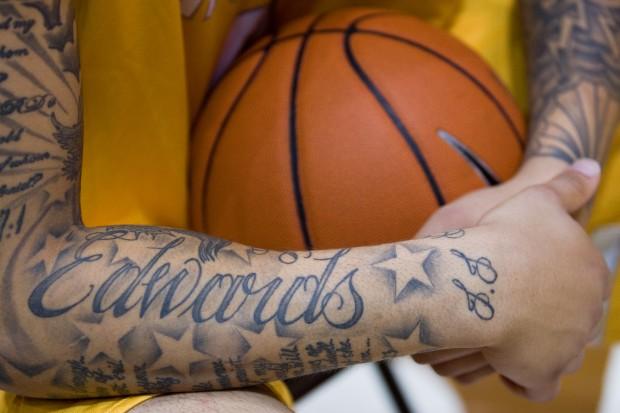 Edwards ready to display artwork valparaiso university for Basketball tattoos on arm