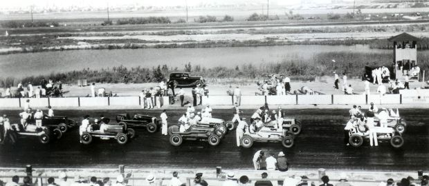 """A field of """"big car"""" racers gets ready for action at the Hammond Raceway."""