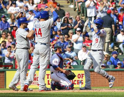 Baez hits 2 HRs as Cubs open season with 12-4 win at Rangers