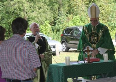 Rev. Terry Bennis with Bishop Donald Hying at Parish Picnic Mass at North Judson Park