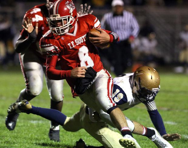 T.F. South quarterback Cody Petrich runs the ball against Lemont