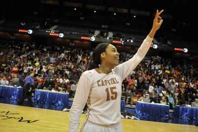 Kiah Gillespie of Capital Prep celebrates her team's Class L championship after defeating Weaver 69-53 in March of 2014.