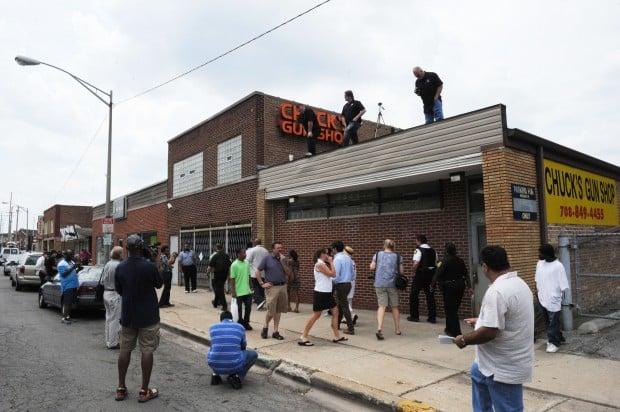 Revs. Jackson, Pfleger picket Riverdale firearms dealer they believe supplies guns to streets