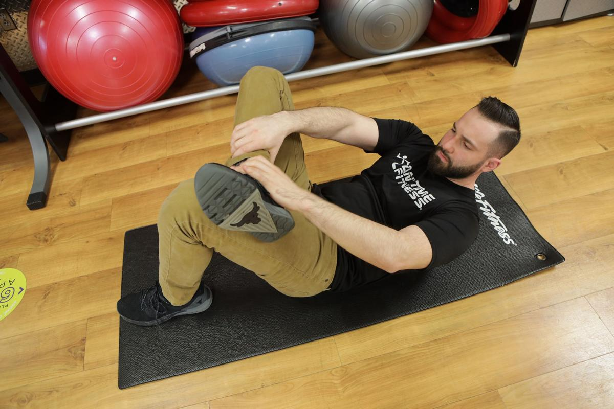 Stretching and weight lifting can get a touchy back in shoveling shape