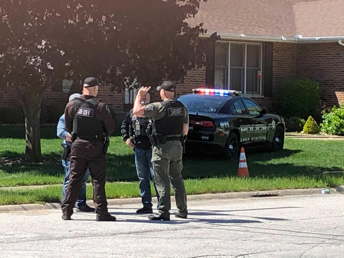 Stolen Lake Station squad car dumped on lawn; cops searching for suspects, police say