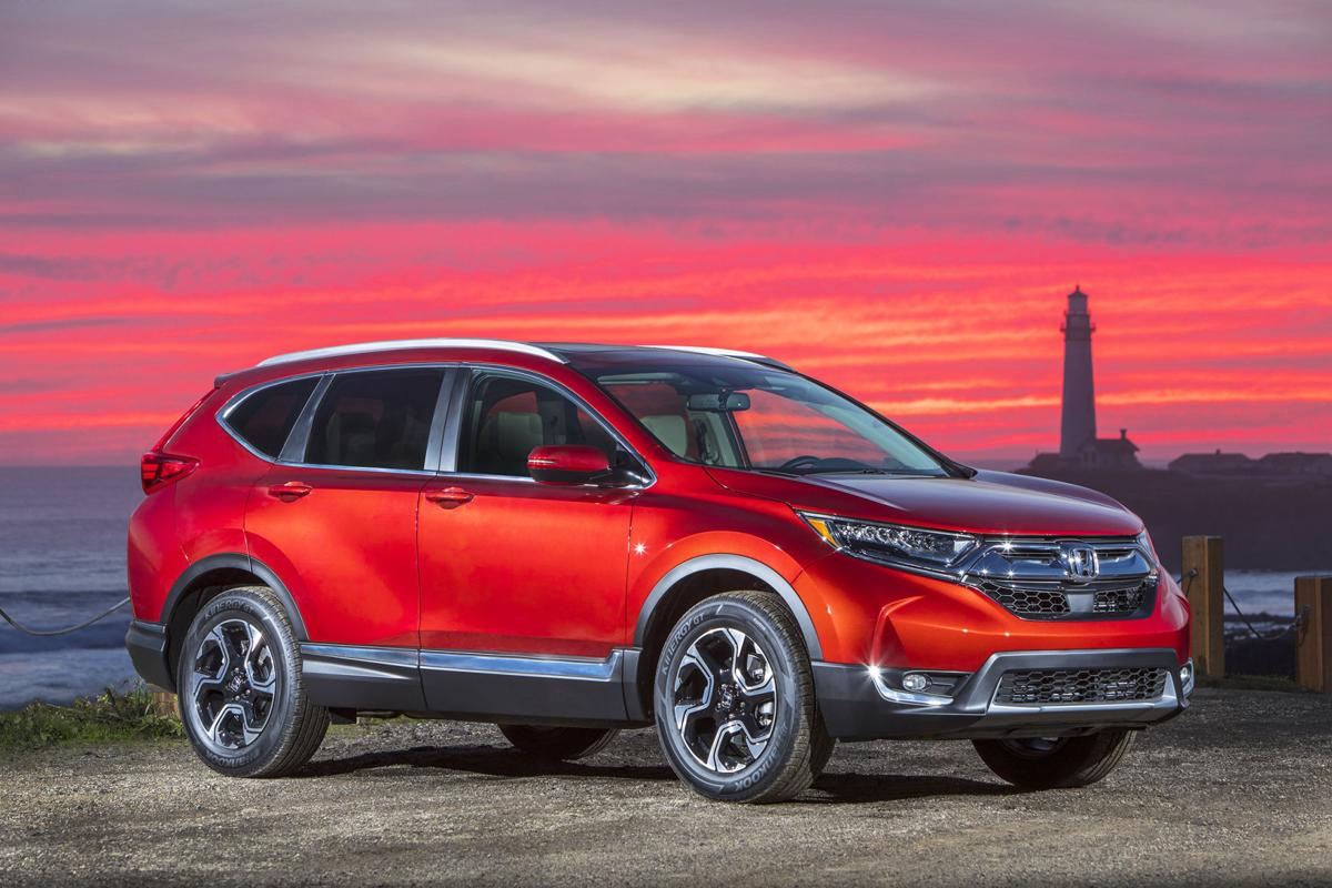 Honda s popular crossover adds turbo engine choice for Is a honda crv a suv