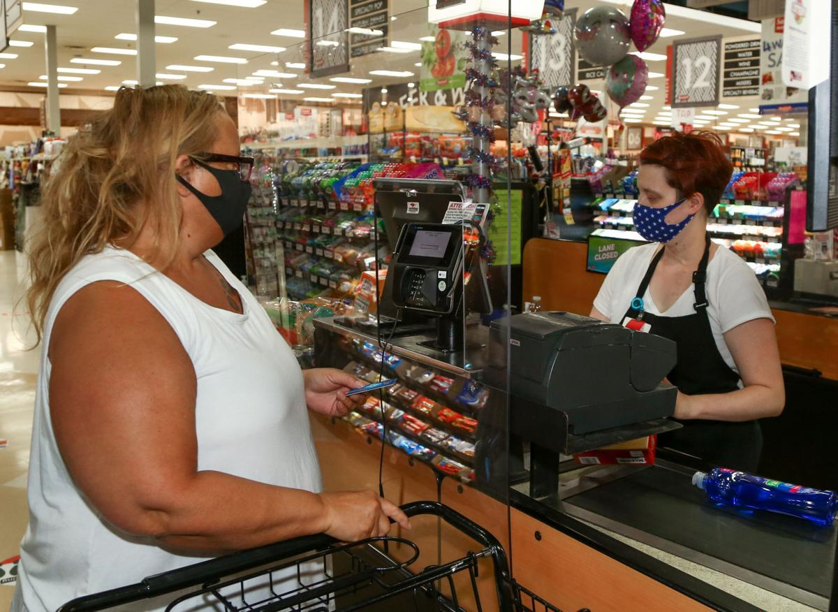 Retailers and municipalities require face masks