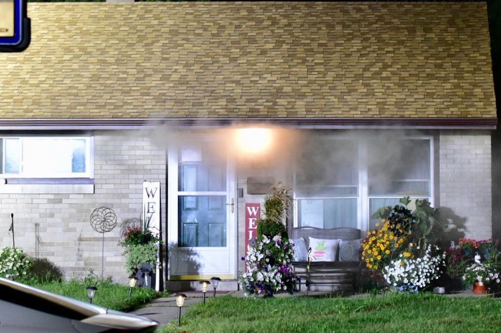 Smoke seen rising from eves after firefighters respond to Griffith home