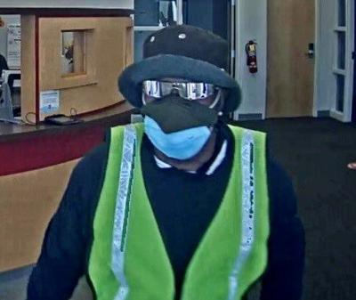 Man charged after cops find $14K, sunglasses in his apartment after bank robbery
