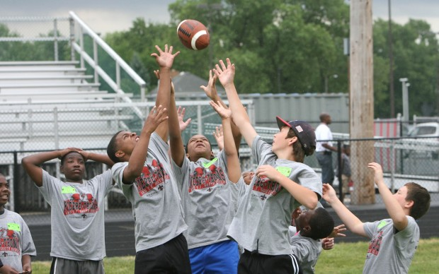 Students participate at the Free Football Skills Day with Pierre Thomas