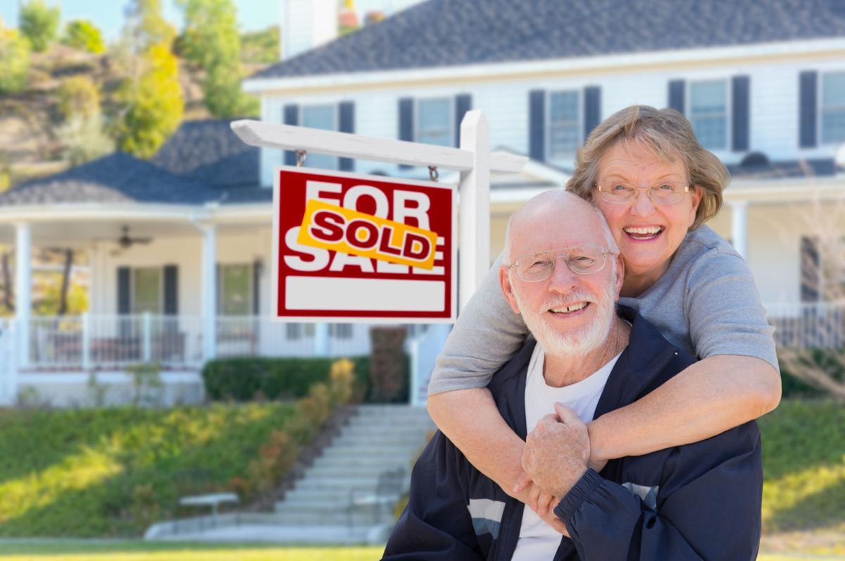 Senior Couple Selling Big House-Dreamstime