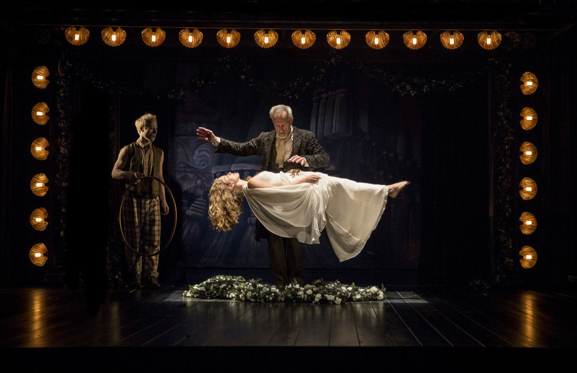 """Larry Yando as Prospero Levitates Daughter Miranda Played by Eva Louise Balistrieri as Spirit Ariel, Played by Nate Dendy, Observes in Chicago Shakespeare Theater's """"The Tempest"""""""