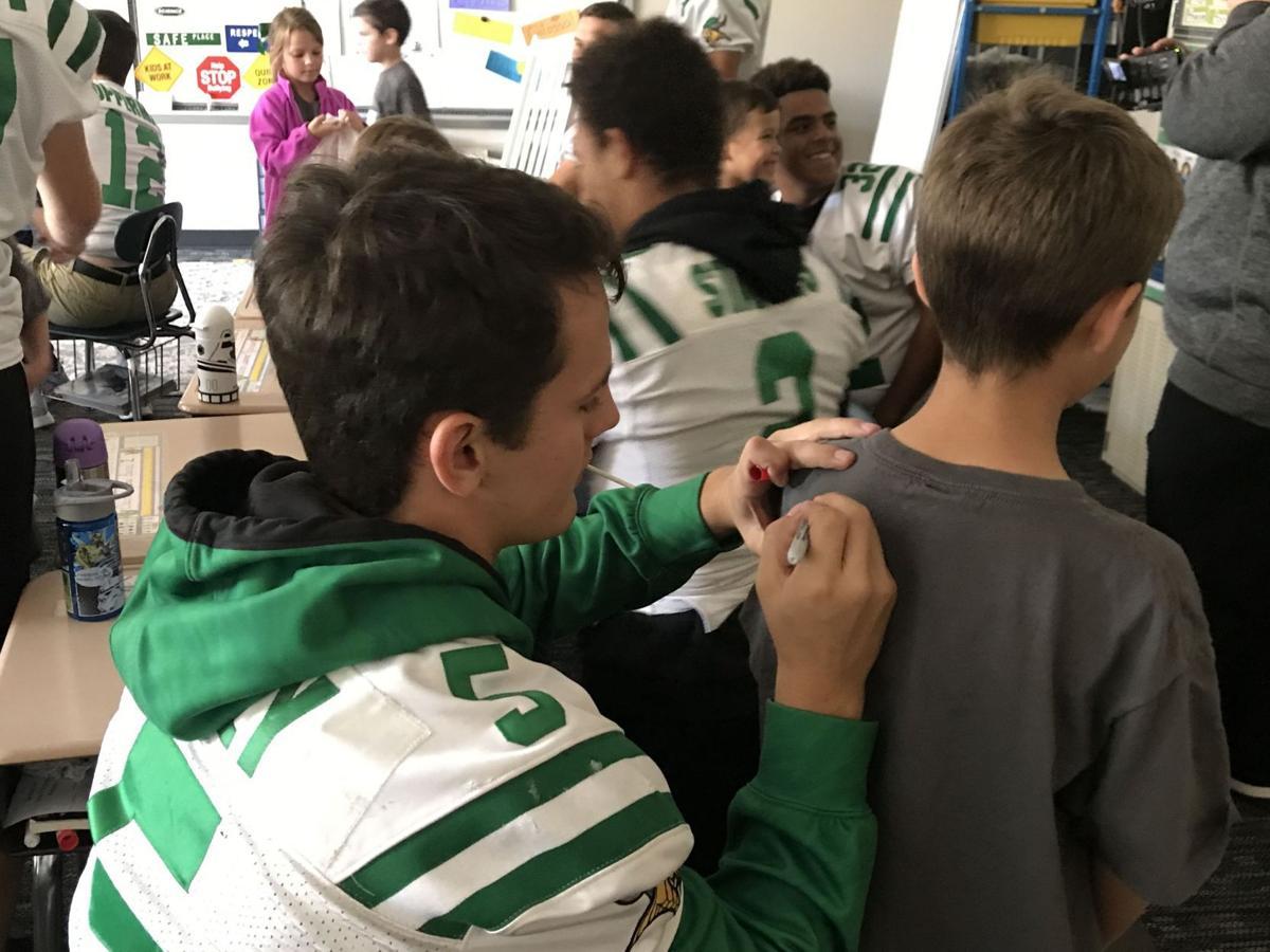 Valparaiso High School football players pay visit to pen