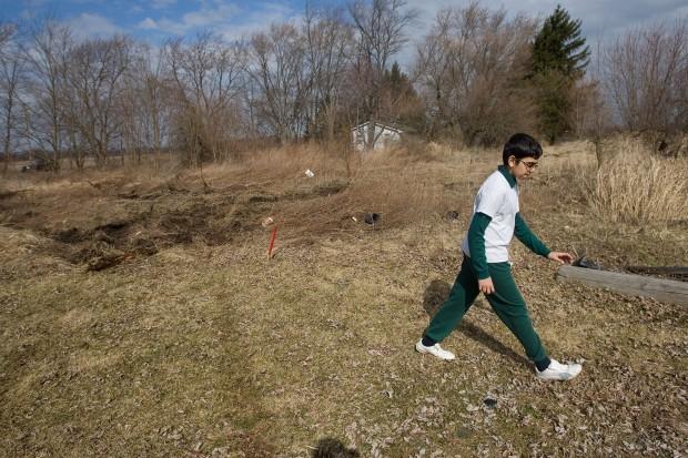 Avicenna Academy students convert land into community garden