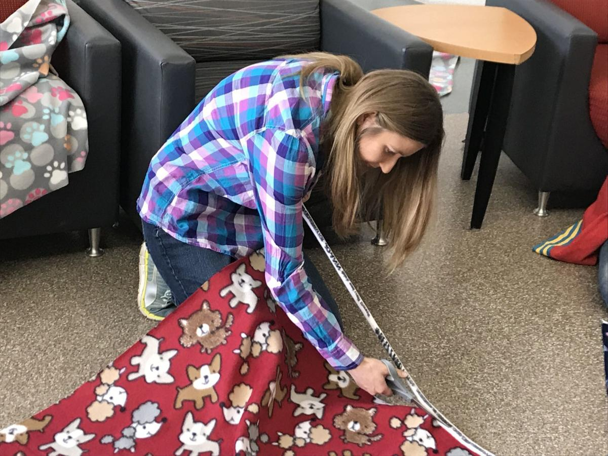 Ivy Tech students make buddy blankets for puppies, kittens as part of Days of Service initiative