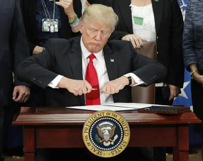 Trump moves to build border wall, cut sanctuary city funds