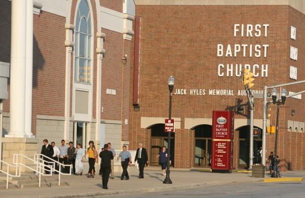 Worshipers file in to First Baptist Church following firing of Pastor Jack Schaap