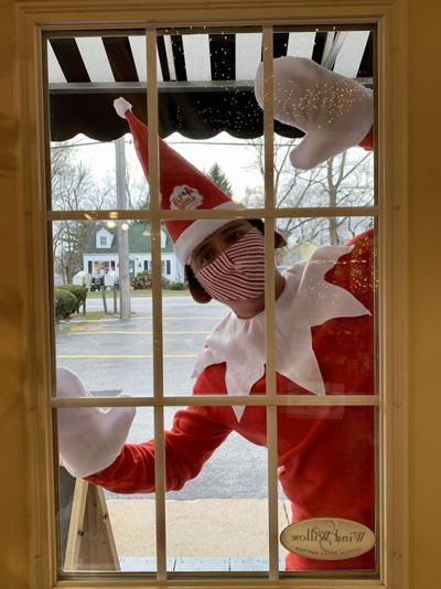 Tinsel the Tea Room Elf making deliveries for the Merrillville Florist and Tea Room